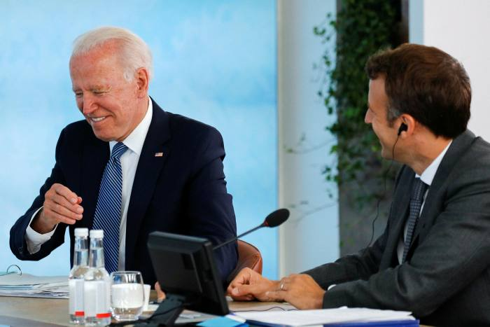Joe Biden and French president Emmanuel Macron at a plenary session of the G7 summit on Sunday