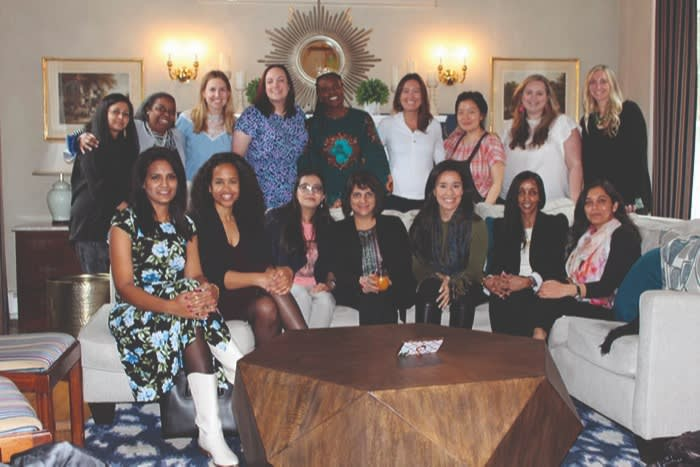 Half of the EMBA cohort were women, some seen here at a social event
