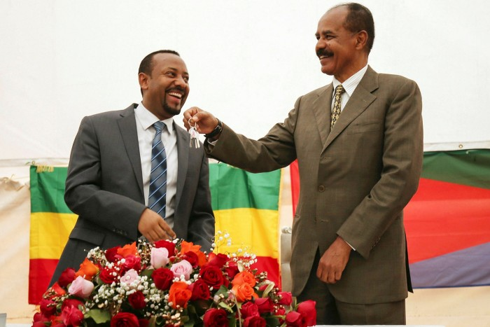 In 2018, Abiy Ahmed, left, made peace with Etritrean President Isaias Afewerki, whose forces have been accused of atrocities in the Tigray conflict