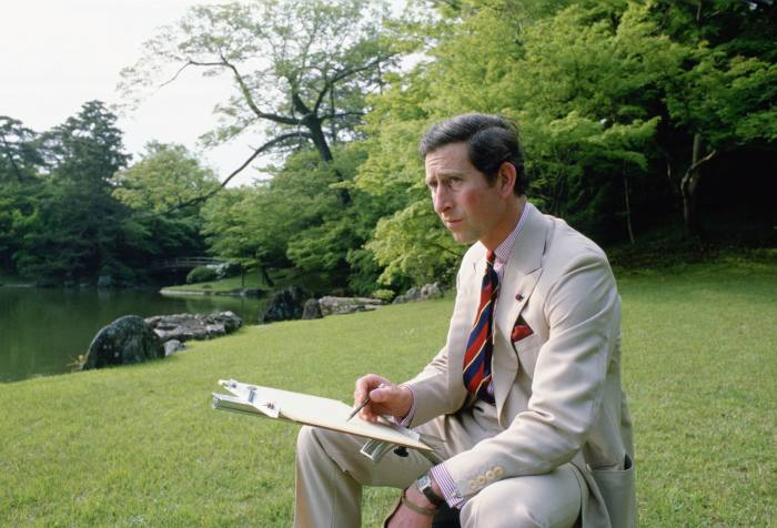 Prince Charles wears a Cartier watch while sketching in Omiya Palace, Japan