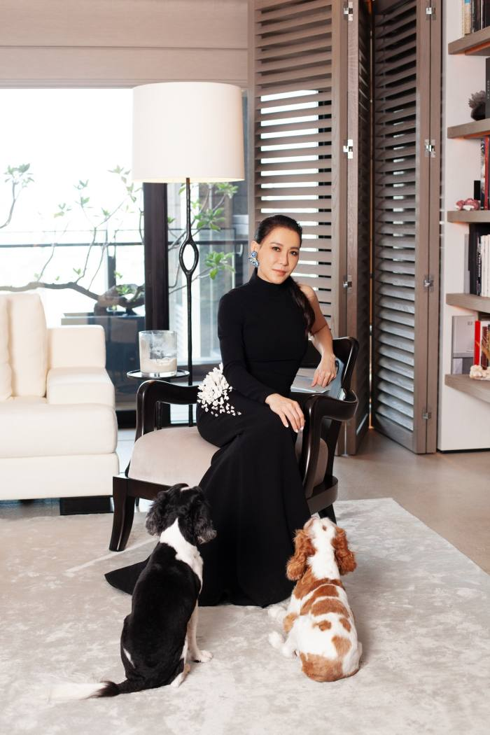 At home with her dogs, Wang Cai and Kooli