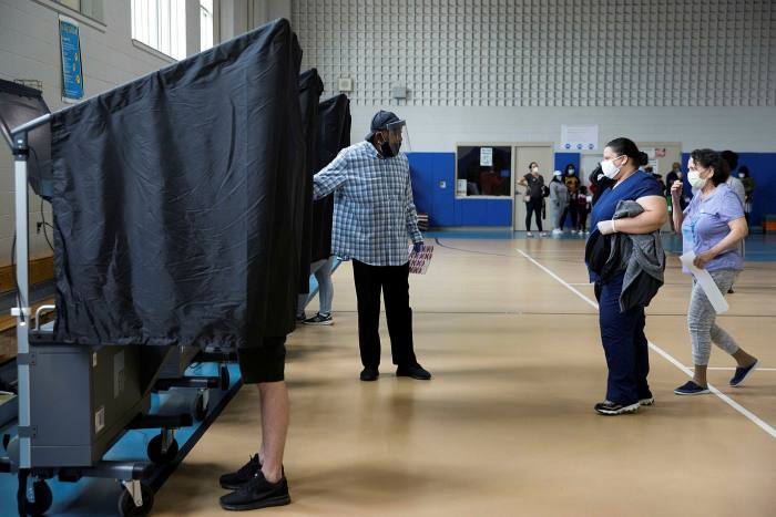 Voters cast their ballots in the Democratic primary in Philadelphia in June. There are signs pointing to a tough climb for Joe Biden outside the state's cities and suburbs