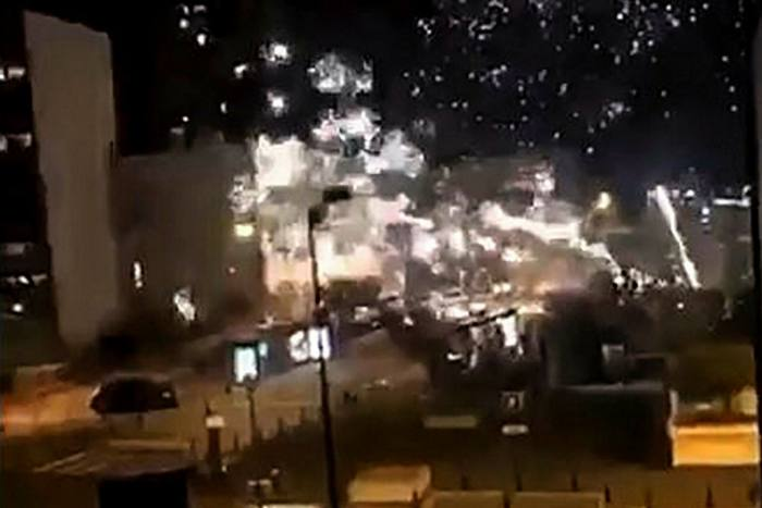 Video footage posted on social media shows fireworks exploding outside the police station