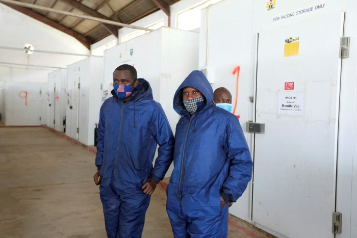 Health workers inside the National Strategic Cold Store facility in Abuja, Nigeria. The country raised its order from the African Union fourfold to 41m doses