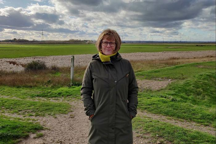 Marie King on England's north Kent coast. She says of the nearby battery storage project: 'We're not against renewable energy — we just think it needs to be in the right place'