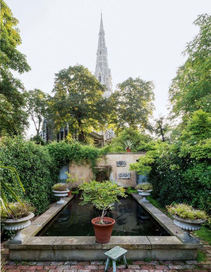 """The south London garden of Will Fisherand Charlotte Freemantle, with its """"Roman villa"""" wall"""