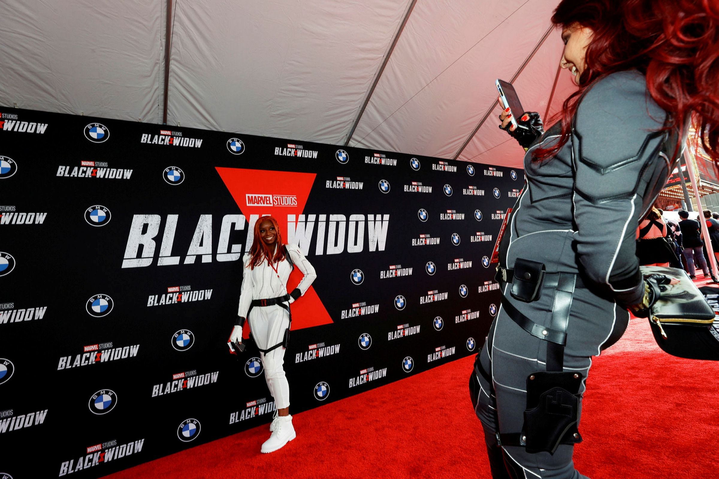 Fans pose at a Black Widow screening in Los Angeles