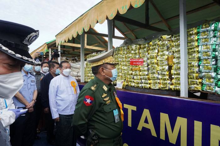 Minister of home affairs lieutenant general Soe Htut inspects a stack of seized drugs during a destruction ceremony to mark the United Nations' 'International Day against Drug Abuse and Illicit Trafficking' in Yangon, Myanmar, in June this year