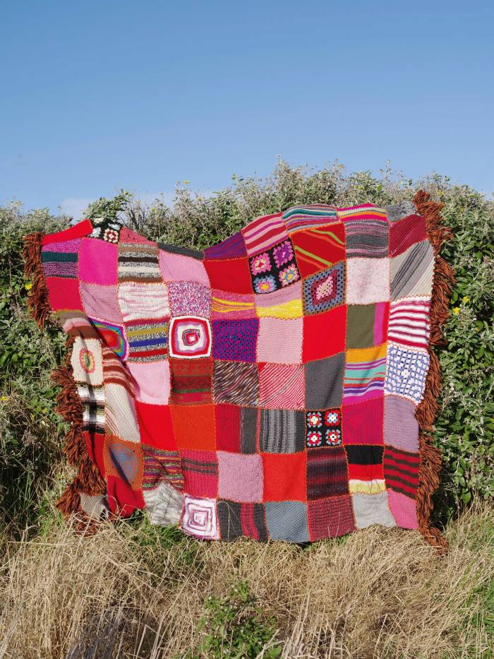 Ahandknitted blanket auctioned by Colville