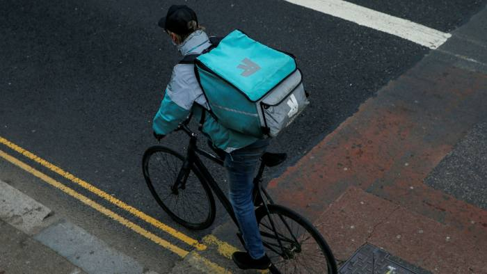 Deliveroo courier on a bike