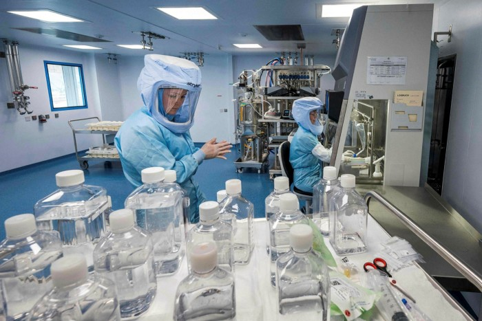 Employees test the procedures for the manufacturing of the messenger RNA (mRNA) for the Covid-19 vaccine at BioNTech in Marburg, Germany