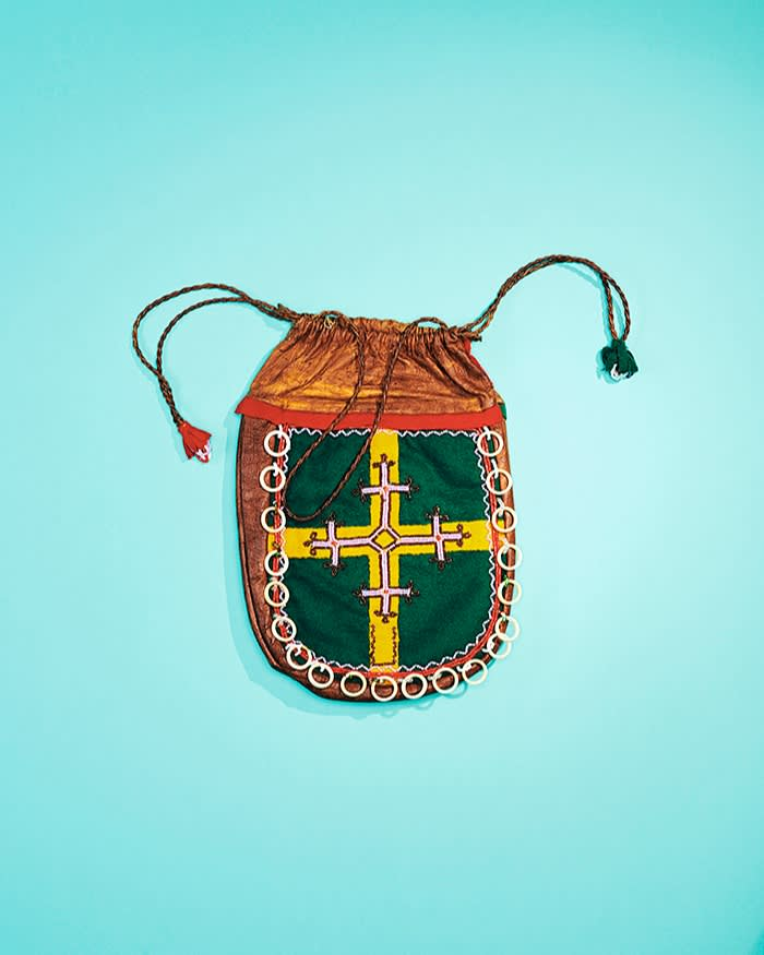 Sàmi reindeer-skin bag with a drawstring handle and tassels decorated on both sides with a cross motif; Jämtland, Sweden. 1900s