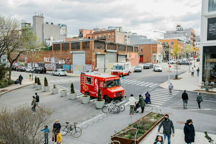 Street in Williamsburg with people walking ann bikes parked