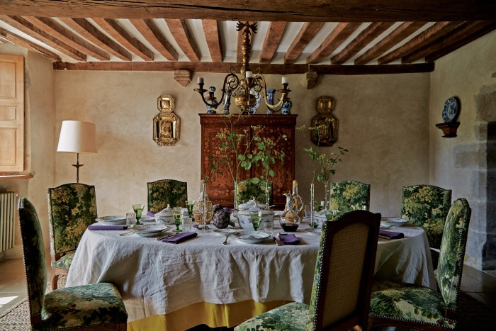 The dining-room table is laid with a Royal Copenhagen dinner service and antique glasses