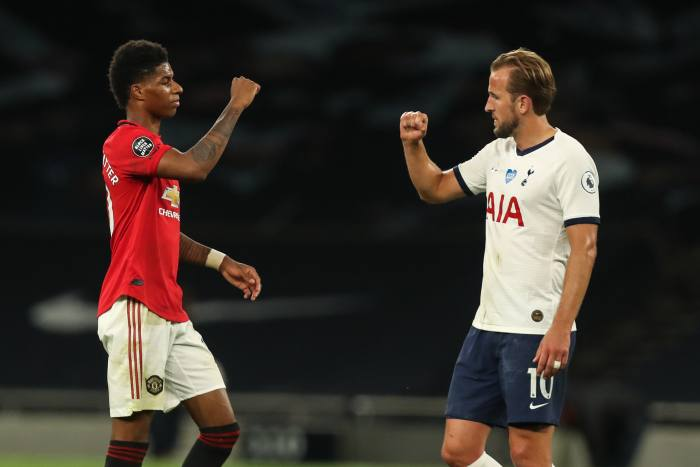 Man Utd's Marcus Rashford and Tottenham captain Harry Kane at the end of the game. As part of the new regime, handshakes are out and goal celebrations are supposed to be solitary affairs