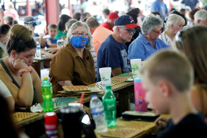 A woman wears a mask while playing bingo at St Jerome Catholic Church in Fancy Farm, Kentucky