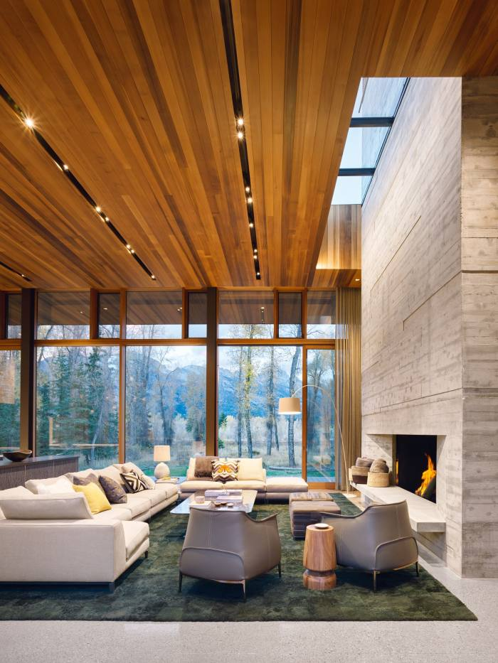 This house by CLB Architects on the banks of the Snake River, near Jackson Hole, Wyoming –built for a Californian couple – is on 5ft-high platforms to maximise views, as seen from the double-height, open-plan living space