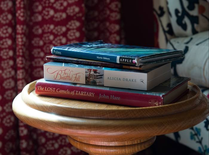 The books on Lyttle's bedside table include In Praise of Shadows by Junichiro Tanizaki and The Beautiful Fall by Alicia Drake