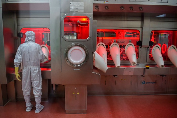 An assembly line for manufacturing vials of Covishield, Oxford/AstraZeneca's vaccine, at India's Serum Institute in Pune
