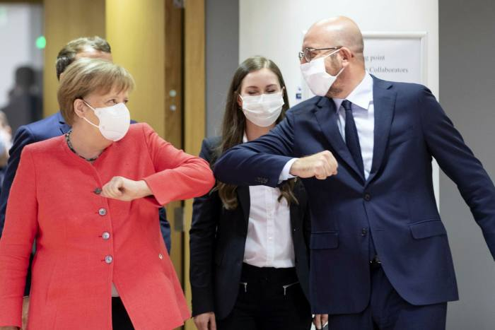 German chancellor Angela Merkel elbow bumps European Council president Charles Michel. Much of the dollar's decline has been against the euro, which has appreciated 10 per cent since May