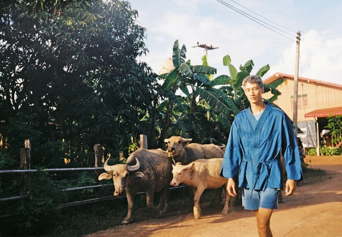 Designer Philip Huang in north-east Thailand,wearing Philip Huang silk and cotton Antto jacket, £510, and cotton Sky Indigo shorts, £275