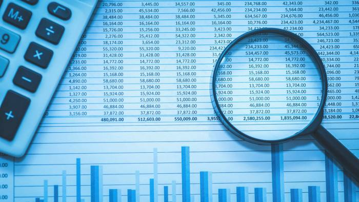 Spreadsheet bank accounts accounting with calculator and magnifying glass