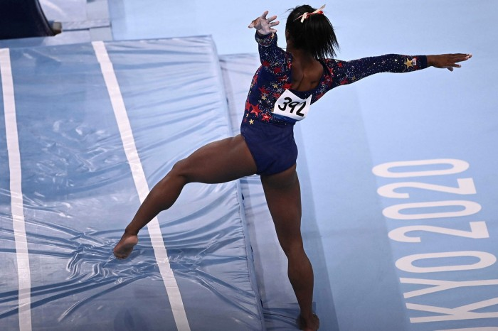 Simone Biles struggles to land her vault during the women's qualifying round at the Tokyo 2020 Olympics