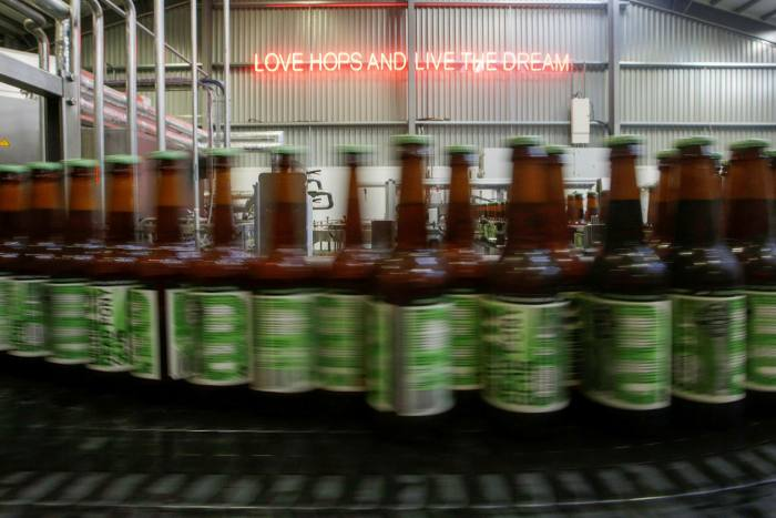 Bottles of Dead Pony Pale Ale on the production line at the Brewdog brewery near Aberdeen