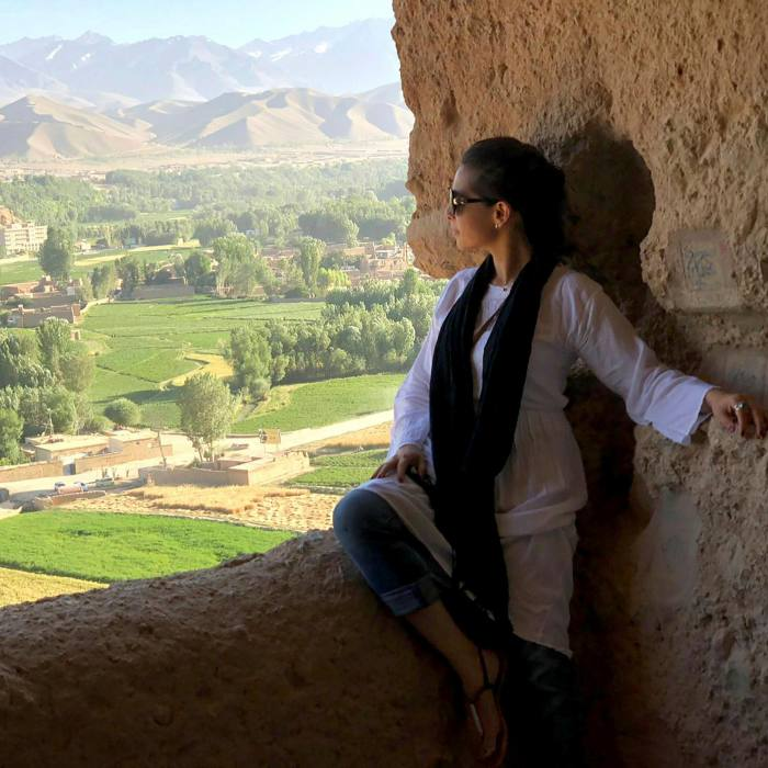 Birashk at the site of one of the Buddhas of Bamyan, which were destroyed by the Taliban in 2001