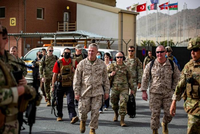 US general Kenneth F. McKenzie touring an evacuation control center at Hamid Karzai International Airport last week