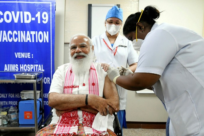 Narendra Modi, Indian prime minister, receives a dose of Covaxin, a vaccine developed by Bharat Biotech and the state-run Indian Council of Medical Research