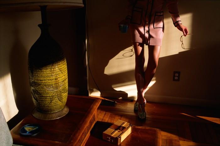 Chanel cashmere dress, £5,105, and velour sandals, £910. Moscot acetate Miltzen glasses, £265. Fendi oak and leather Mini Baguette Trunk clutch, £3,650