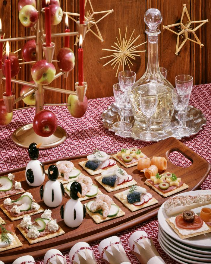 A festive buffet from the 1960s, Smorgasbord hors d'oeuvres with Christmas apple tree and penguins made from hard-boiled eggs