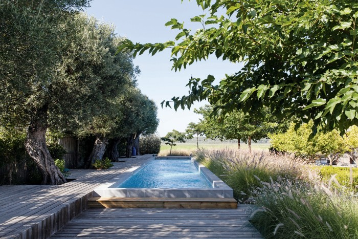 The pool in the Comporta house of Frenchwoman Florence Grinda looks over rice fields
