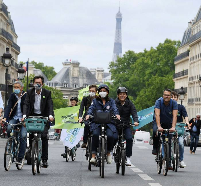 Paris mayor Anne Hidalgo cycling through the city in June. During lockdown, she expanded her 'Paris Respire' programme, turning miles of traffic lanes into bike-friendly 'corona pistes'