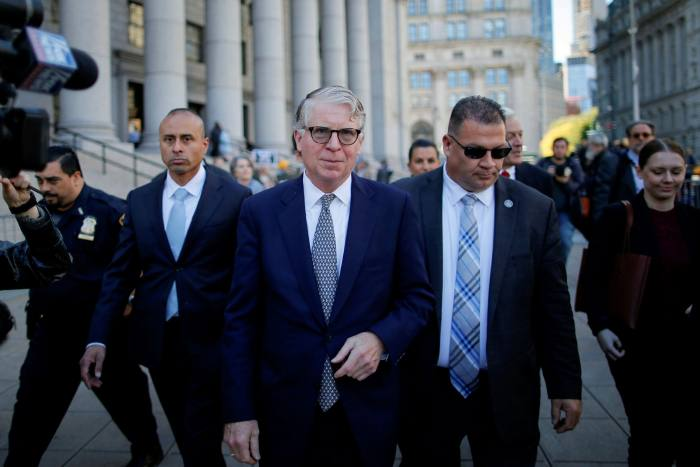 Manhattan district attorney Cyrus Vance, centre, who is exploring whether The Trump Organization engaged in any banking, tax or insurance-related fraud