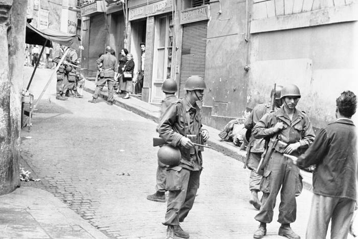 French soldiers searching house-to-house in Casbah, Algiers in May 1956
