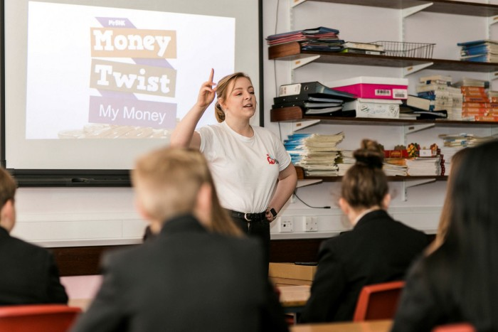 Natalie Bartlett of MyBnk helps teenagers become canny consumers in a lesson supported by the Quilter Foundation