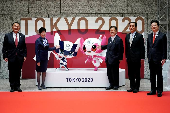 Japan Olympic Committee president Yasuhiro Yamashita, left: 'We have been provided with an opportunity to look again at what the Olympics are about'