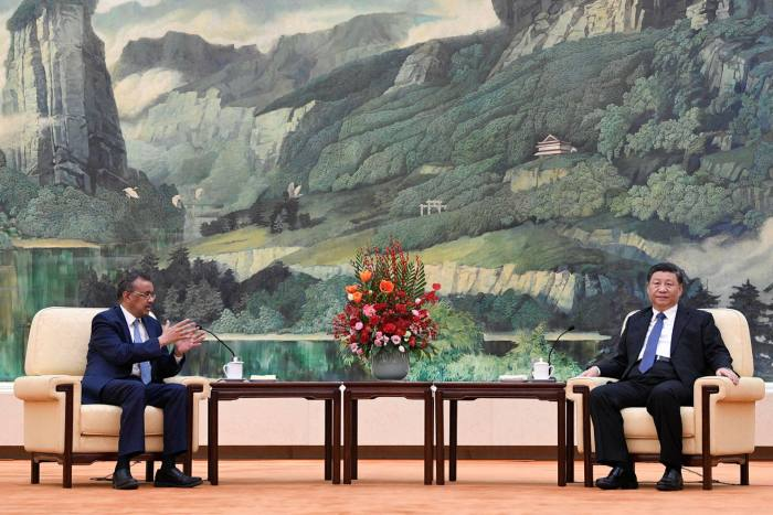 WHO director-general Tedros Adhanom Ghebreyesus meets Xi Jinping in Beijing in January. Mr Xi said China would back an 'objective and impartial' WHO review, but only after the crisis passes and if it does not focus solely on China