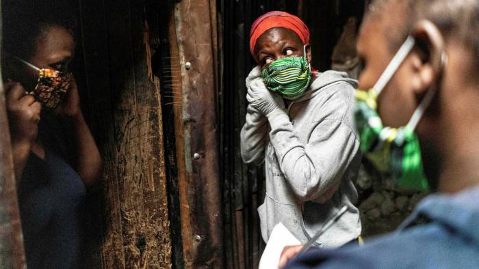 People learning to put on face masks in Nairobi