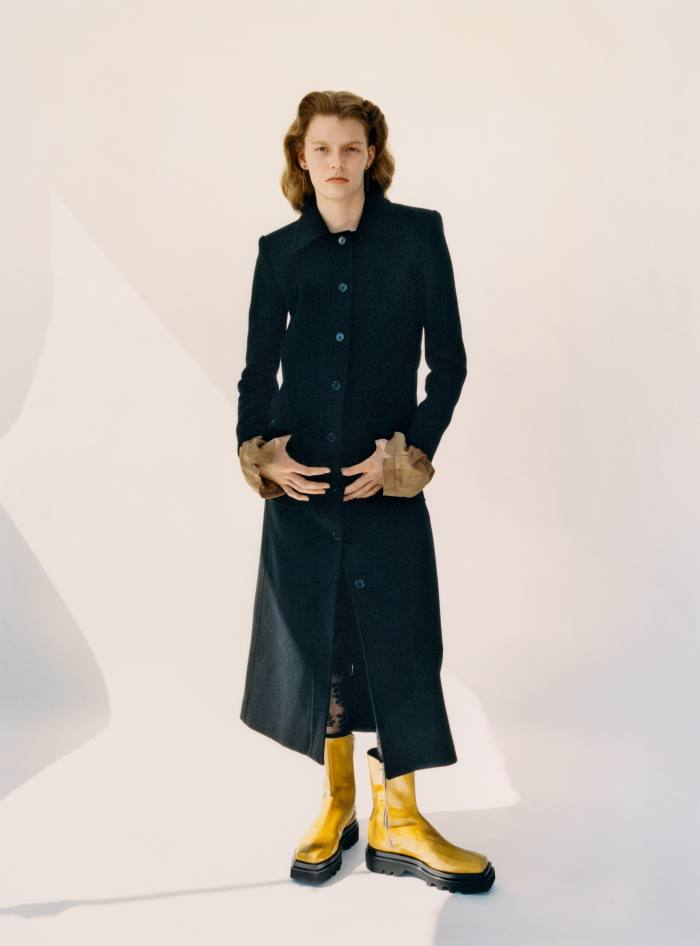 Saint Laurent by Anthony Vaccarello wool jersey coat, £2,270. Peter Do viscose Flowers top(cuffs showing), £327,andleather boots, £765. Calzedonia lace tights, £13.Earrings, stylist's own