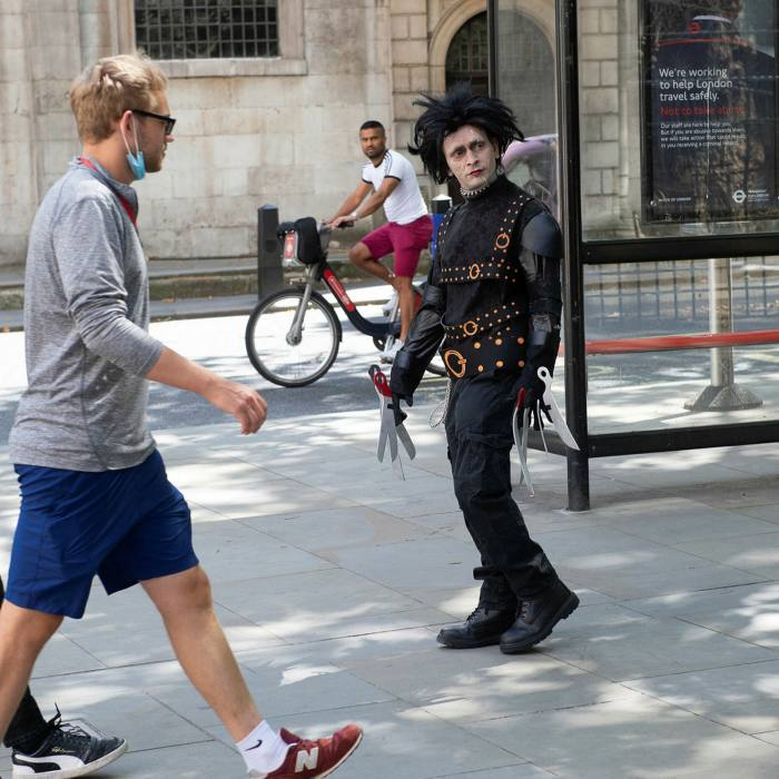 A fan dressed as Depp's onscreen character Edward Scissorhands, near the Royal Courts of Justice during the trial . . .