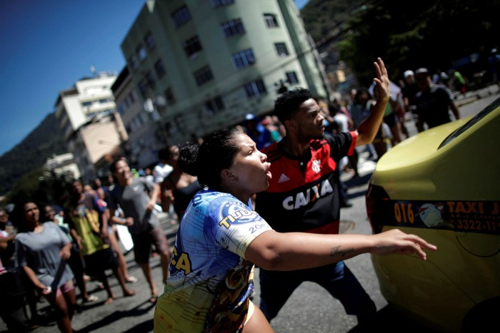 Anti-crime protesters march in Borel favela. Almost 60% of the city of Rio and more than 20% of the greater metropolitan area is controlled by mafia syndicates
