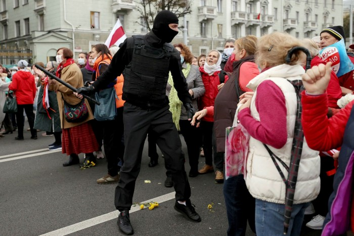 Pensioners argue with a law enforcement officer during a rally to demand the resignation of Alexander Lukashenko and new fair elections in Minsk last year
