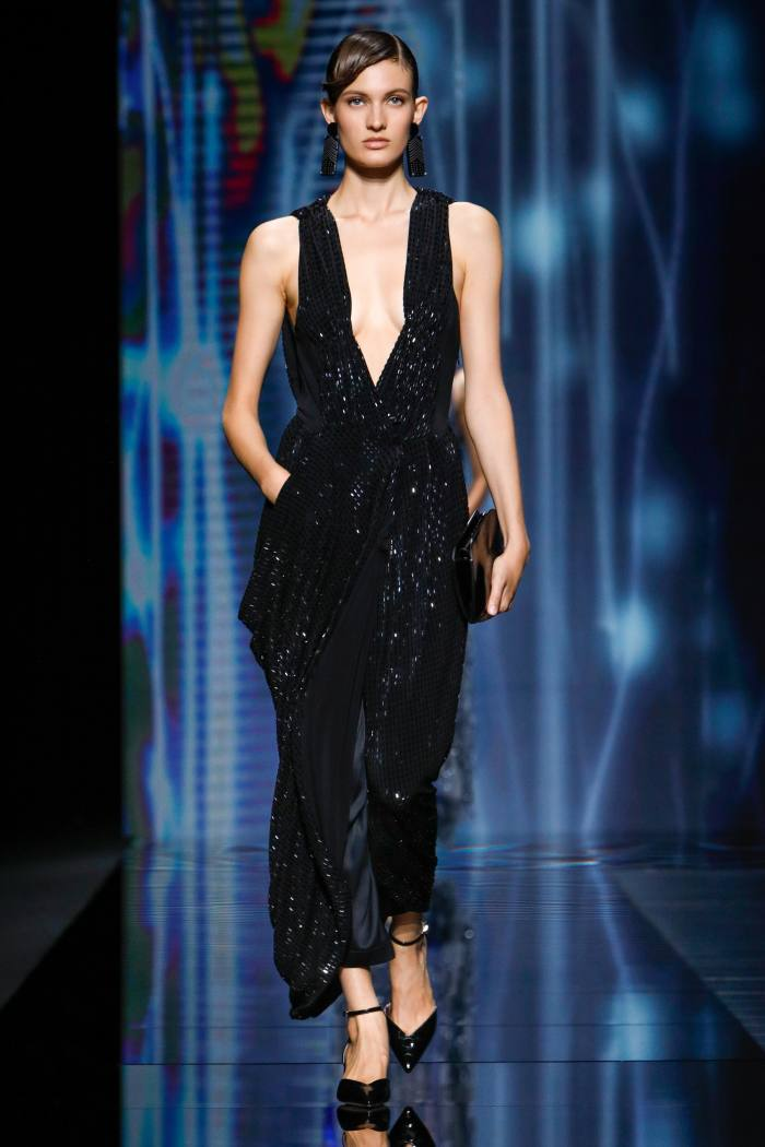 Giorgio Armani jersey dress, £4,250, and satin trousers, £1,150. Patent leather Décolleté shoes, £560, leather clutch, £910, and plexi earrings, £240