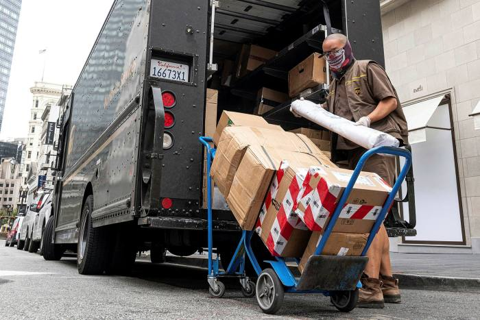 UPS driver unloads packages for delivery in San Francisco