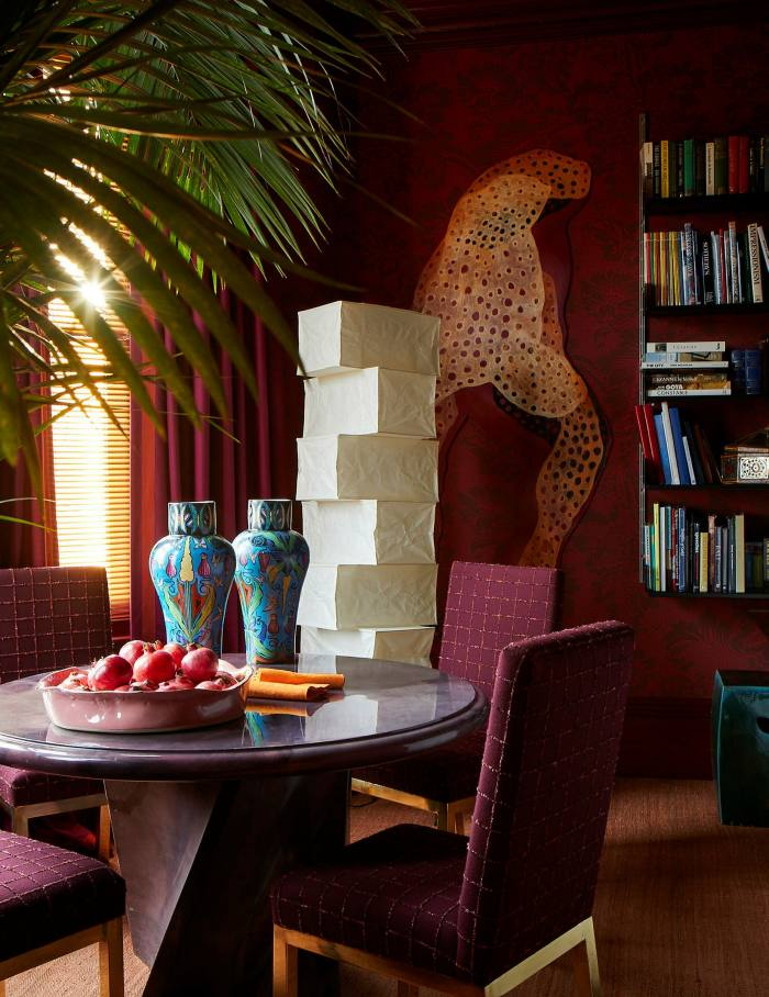In this Chelsea flat, the dining room designed by Patrick Mele doubles as a library