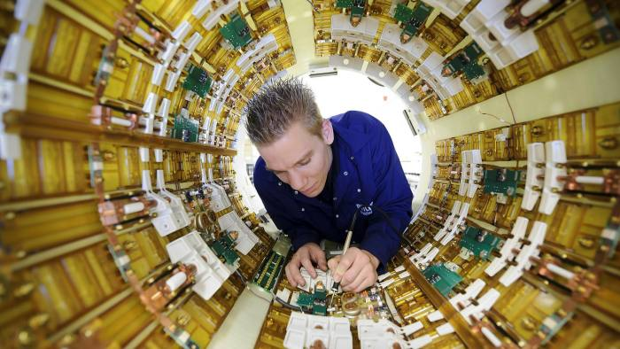 An engineer working on a Philips Healthcare MRI scanner. Healthcare is a sector that is expected to expand as the global population of over 65s increases