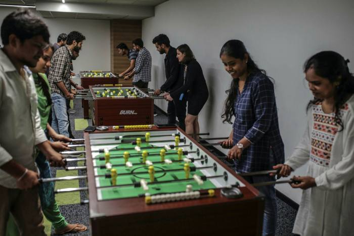 Employees play table-football during their lunch break at the Amazon.com office campus in Hyderabad, India, in September 2019
